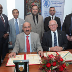 Pictured (front, left to right) are Major General Dr Mohammad Ahmed Bin Fahad and IPSA chairman Mike White signing the Memorandum of Understanding, watched by (back, left to right) Adil Abdel-Hadi , First Lieutenant Fahd Jassem, Colonel Dr Gaith Ganim Al Suwaidi, Lt Colonel Nasser Ibrahim Kazim and IPSA's CEO Justin Bentley