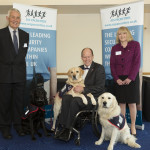 Terry O'Neil and Lynda Moore from FM Contract Watch pictured with Hounds for Heroes' founder Allen Parton