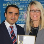 Ward Security's Nikhil Kamboj (compliance director) and Liana Dodd (HR director) proudly display the company's latest Investors in People certification