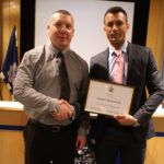 Terry Vass, Brunel University's operations manager (left) accepts the Partnership and Engagement Award from Chief Inspector Roy Smith, the Met's strategic lead for business crime