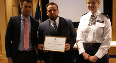 Left to Right: Chief Inspector Roy Smith presents the Award for Outstanding Act to door supervisor Yoram Ouanounou of Vigilant Business Protection. Also pictured is Croydon PC Louise Kellam. Ouanounou went to PC Kellam's aid in the town centre last January
