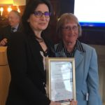 Lisa Sharkey receives her Honorary Fellowship certificate from Baroness Ruth Henig