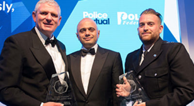 Left to Right: PC Shaun Cartwright, who accepted PC Keith Palmer's posthumous award, Home Secretary Sajid Savid and PC Charlie Guenigault