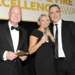 Jeff Johnson (left, director of SSR Personnel) with Vicky Paine (HR director of Axis Communications) and actor James Nisbett, who hosted the IFSEC Security and Fire Excellence Awards Ceremony 2018