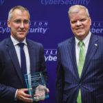 Ciaran Martin (left) receives the award in Washington DC