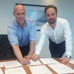 Binns Fencing's managing director Adam Binns (left) and Alastair Henman of Zaun sign on the dotted line