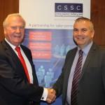Don Randall MBE (left) congratulates Ward Security's managing director David Ward