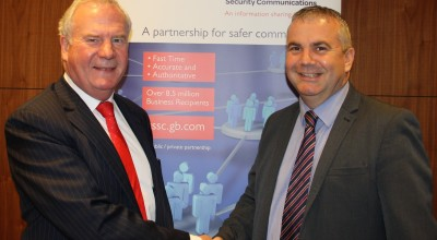 Don Randall MBE (left) congratulates Ward Security's managing director David Ward