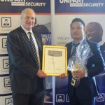 Mark Tonks (left) presents Yubraj Gurung with the Security Officer of the Year Award