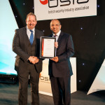 Compere Alfie Moore (left) presents VSG's Donald Murray with his award