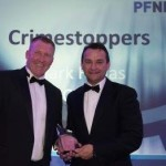 Crimestoppers CEO Mark Hallas accepts the award from the Police Federation National Detectives' Forum's chairman Martin Plummer