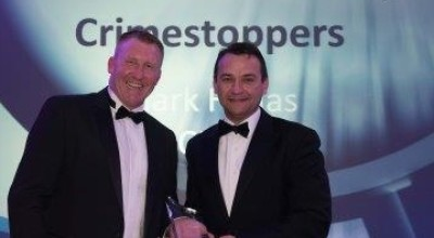 Crimestoppers CEO Mark Hallas accepts the award from the PFNDF's Martin Plummer