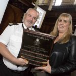 Julie Edwards, operations manager for Selfridges, accepts GMP's Business Crime Co-ordinator of the Year Award from ACC Garry Shewan
