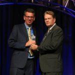 ASIS International's president David Davis CPP (right) presents an Award of Merit to Professor Martin Gill CSyP