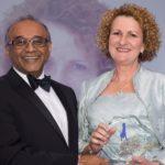 Elizabeth Sheldon receives her Women Leaders Award from Jiten Patel of category sponsor The Open University