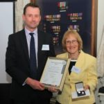 Brian Dillon FSyI is presented with his award by Baroness Ruth Henig