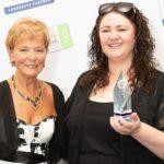 Ashton Kingdon (right) receives the 2018 Wilf Knight Award from Patricia Knight