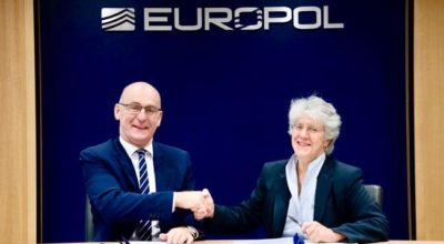 Steven Wilson and Maria Vello sign the Memorandum of Understanding at Europol's headquarters