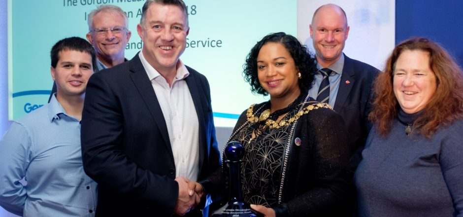 Kevin Thomas (of the Cornwall Fire & Rescue Service) being presented with the 2018 Gordon McLanaghan Award by Cleo Lake, the Lord Mayor of Bristol (Photo: Jon Craig)