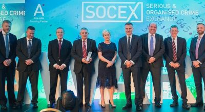 Representatives from the Surrey Police Economic Crime Unit and the South East Regional Organised Crime Unit Cyber and Digital Task Force receive their award