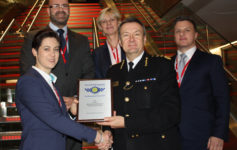 City of London Police Commissioner Ian Dyson presents Aon and Mitie representatives with the 'Secured Environments' accreditation